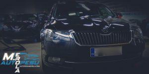 Autopesu M.Erola logo ja auto valokuva